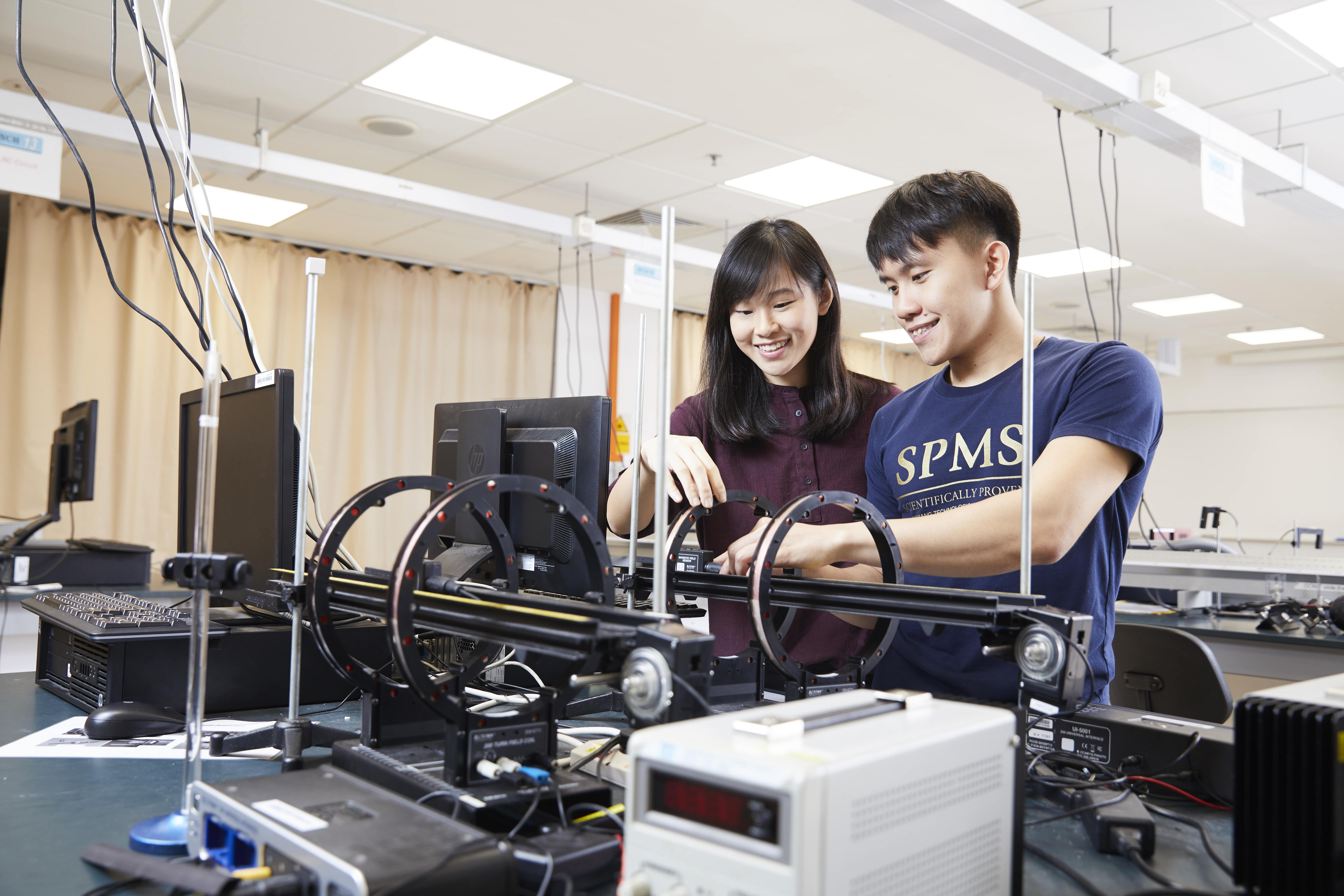 Two students in a SPMS lab